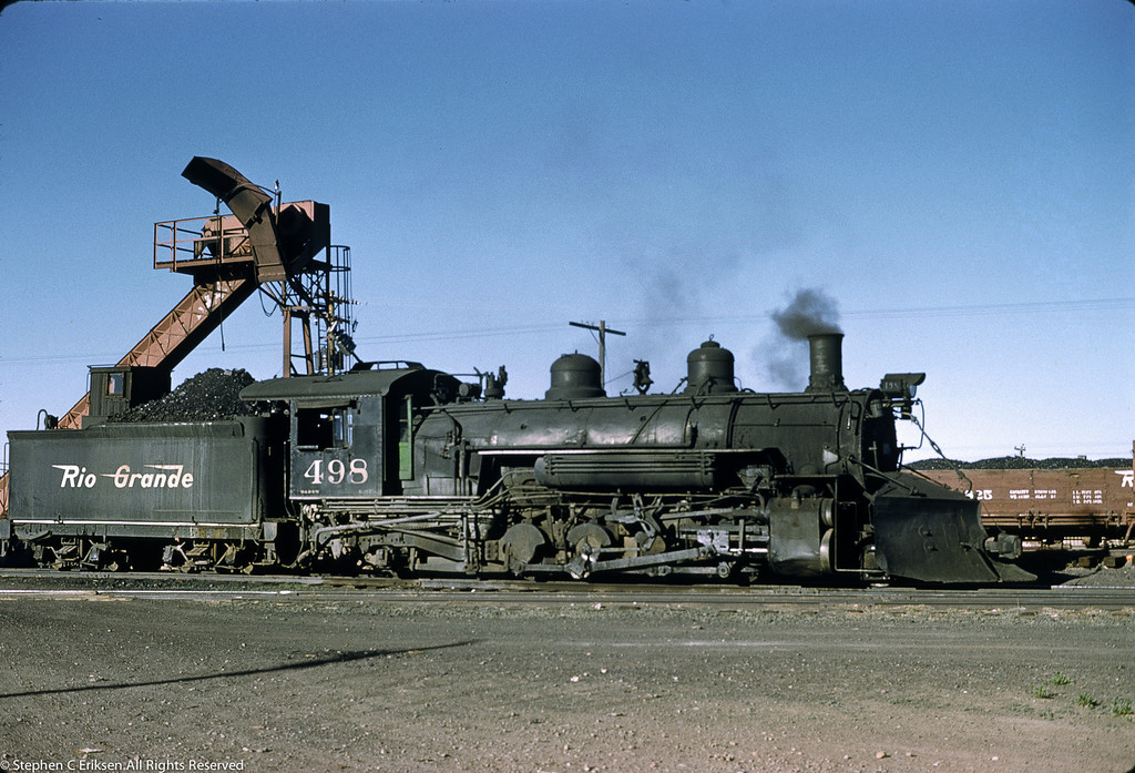 This May 28, 1959 view shows narrow gauge K-37 #498 taking on a heap of coal in Antonito prior to its daily chores.