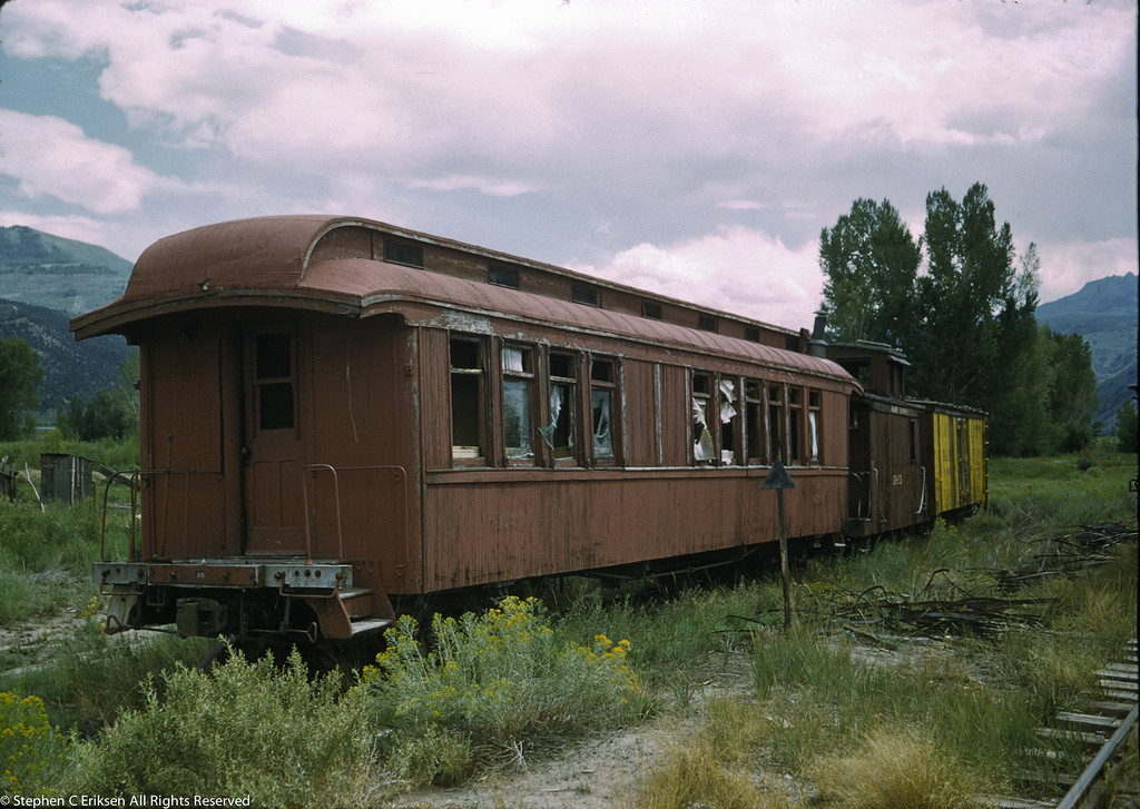 Coach 260 still sitting in the same spot on a track in Ridgway, CO in August of 1959. Photo by Don Swanson.