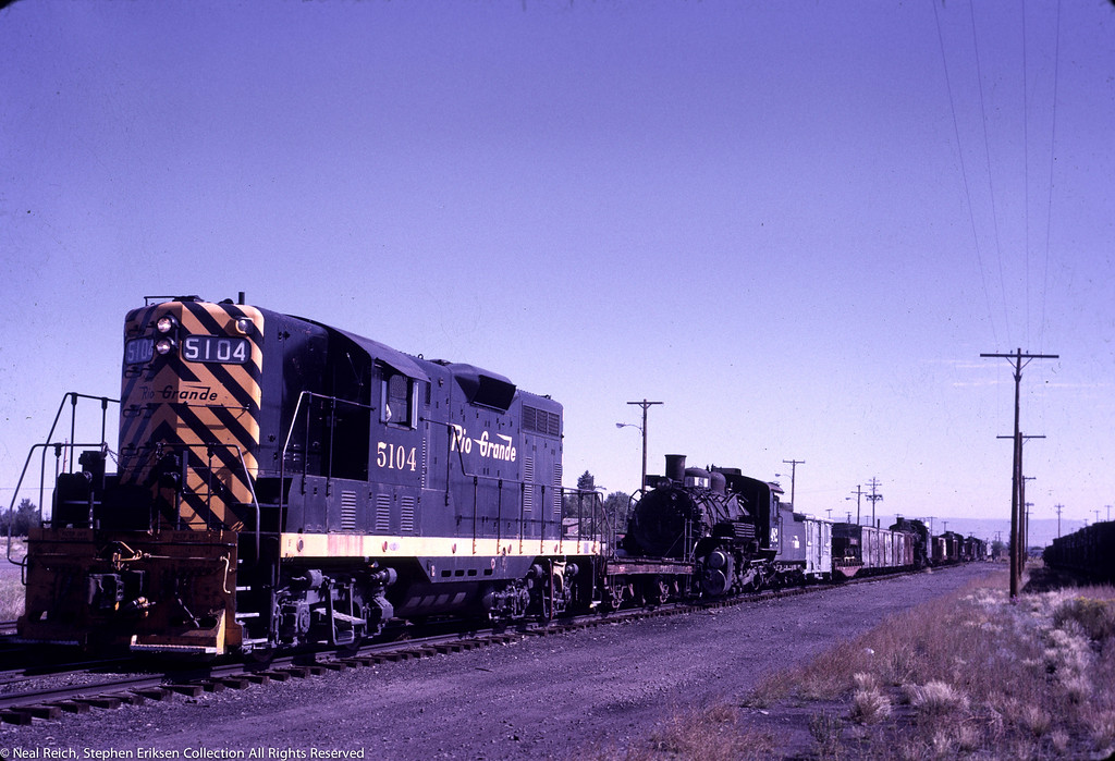 Narrow gauge equipment is on the move on September 18th, 1970 in Antonito, CO.