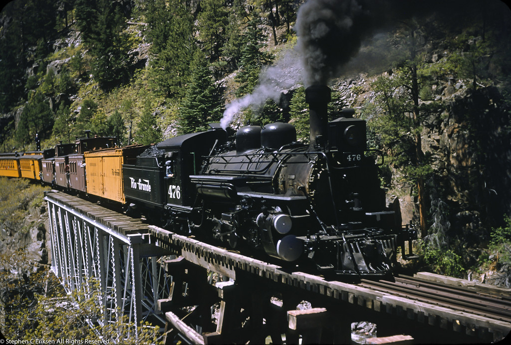 #476 shown with three (!) cabooses in tow on the Animas Bridge near Tacoma, Colorado on May 29, 1955.