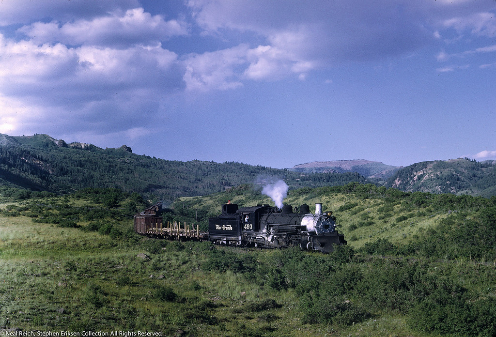 #493 with freight train west of Cresco, CO. on July 17, 1968.